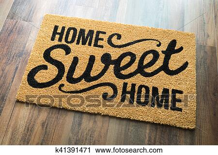 Stock Photography Home Sweet Welcome Mat On Floor Fotosearch Search Photos