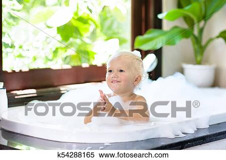 Stock Image of Child in bubble bath. Kid bathing. Baby in shower ...