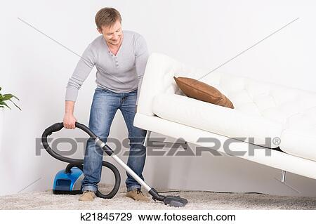 Stock Photograph Of Man Does House Work With Vacuum Cleaner Men