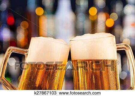 stock photo of jugs of beer served on bar counter k27867103 search