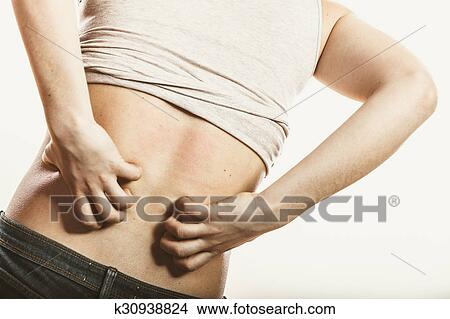 Human scratching itchy back skin  Rash  Picture