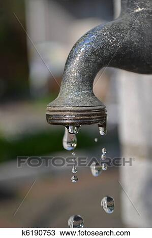 A Garden Water Faucet Tap With Water Drops