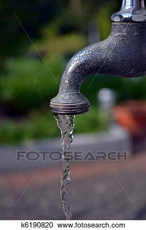 Stock Photography   Running Garden Faucet Tap Close Up. Fotosearch   Search  Stock Photos,