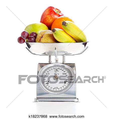 pictures of vegetables and fruits on a weighing scale k18237868