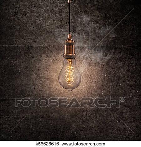 Vintage Edison Light Bulb On Dark Background Stock Photograph K56626616 Fotosearch