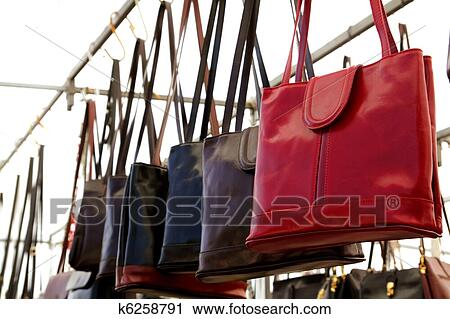 Bags Rows In Retail Handbags Leather Red Foreground