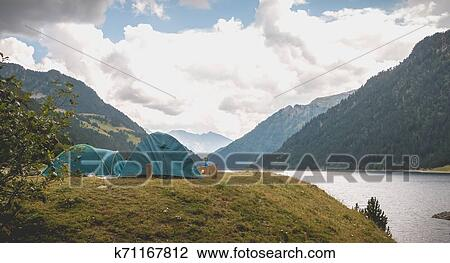 Wild camping atmosphere on a lake in the middle of the ...