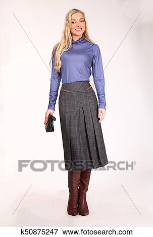 0a7c7f124eb Blond business woman with pony tail hair style in strech blue blouse and  skirt stiletto heels boots full body portrait isolated on white