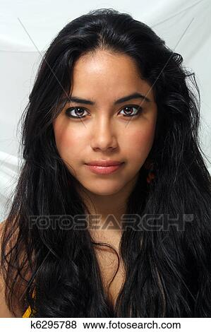 https://fscomps.fotosearch.com/compc/CSP/CSP629/beautiful-latina-headshot-1-pictures__k6295788.jpg