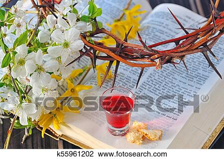 Communion cup with wine and bread Stock Image