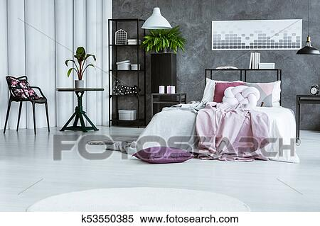 Woman\'s bedroom with black chair Stock Photography