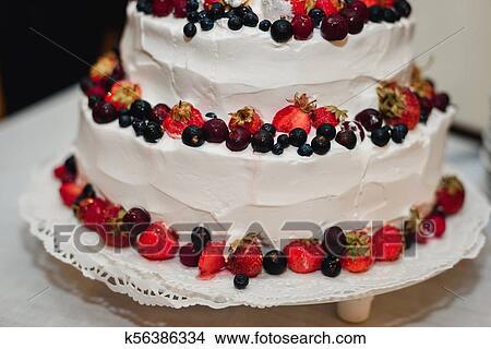 Stock Photo Of White Cream Wedding Cake With Fresh Strawberries