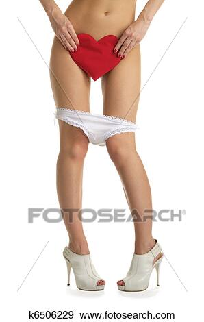 Female Legs With White Panties And Heart Isolated On White