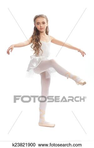 07f65b32e06d Stock Image - young girl in her dance clothes reaching down to touch her  foot.
