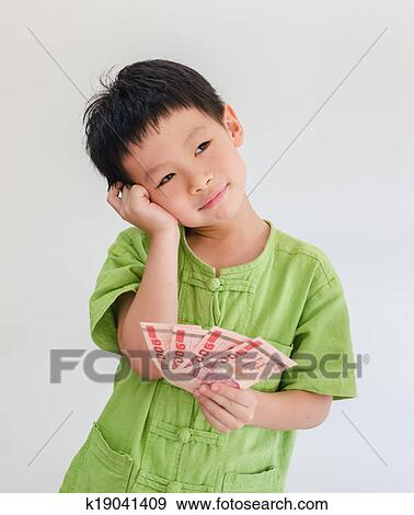 Stock Photograph Asian Boy Thinking With Holding Thai Money On Hand Over White Ba