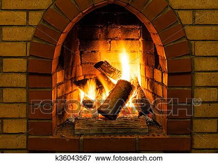 Burning Wooden Logs In Brick Fireplace Country Cottage