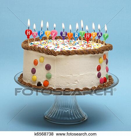 A Cake And Its Candles That Read Happy Birthday