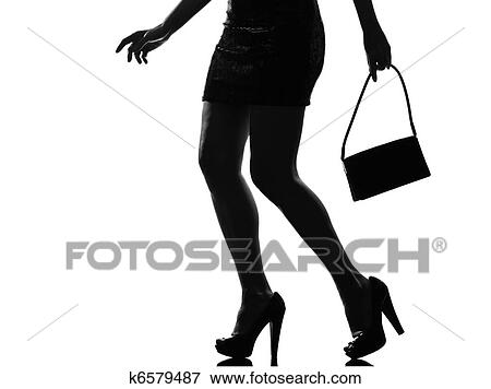Stylish Sexy Silhouette Caucasian Beautiful Woman Legs Closeup Details Walking On Studio Isolated White Background