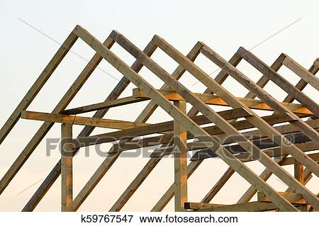 Close Up Detail Of New Attic Wooden Roof Frame Against Clear Sky