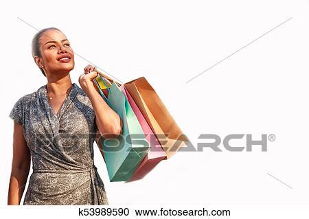 39a5bc941119 Mulher asian, comprador, é, shopping, e, segurando, coloridos, bolsas para  compras, olhar, sideway, ligado, a, esquerda, e, espaço cópia, ligado, a,  ...