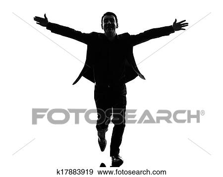 stock photograph of business man arms outstretched silhouette