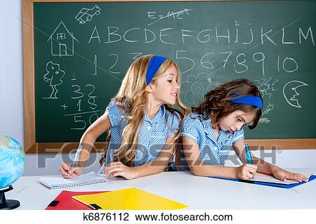 Classroom with two kids students cheating on test Stock Image