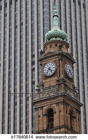 stock photo of old victorian clock tower in sydney central business