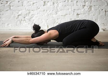young yogi attractive woman in child pose white loft