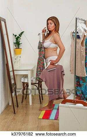 Beautiful Fat Woman In Underwear Trying Dresses Wardrobe Room At Home Lady Looking Mirror And Thinking Of Perfect Dress For Party