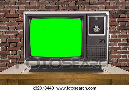 Old Television and Chroma Key Green Screen and Brick Wall Stock Image