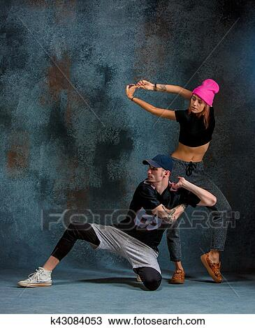 stock photo of the two young girl and boy dancing hip hop in the