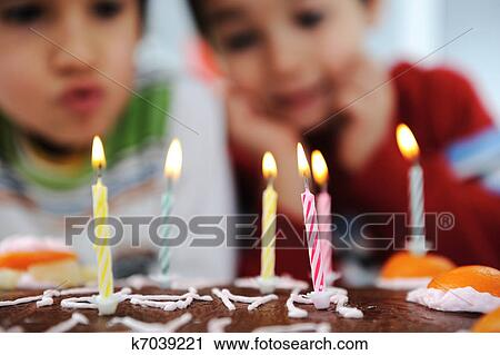 Two Little Boys Blowing Candles On Cake Happy Birthday Party Stock