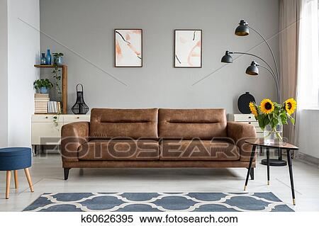 Tremendous Sunflowers On Wooden Table Next To Leather Sofa In Living Uwap Interior Chair Design Uwaporg