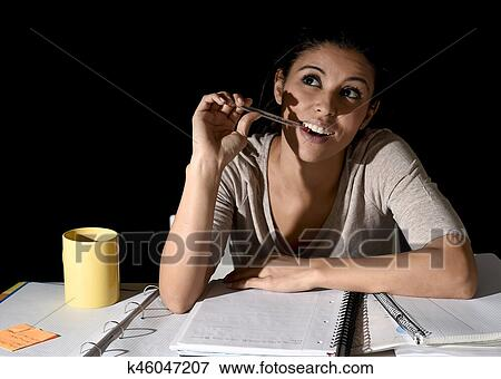 Picture of Spanish girl studying tired and bored at home late night ...