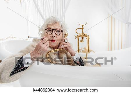 Rich Old Woman Having Fun In Bathroom Picture