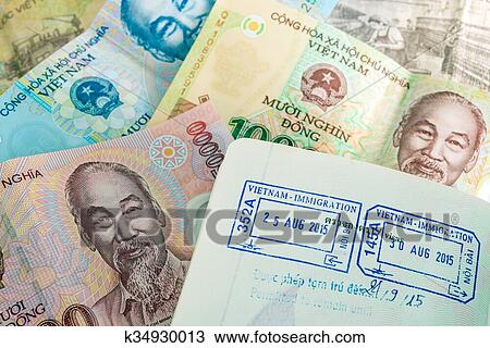 Stock Photo Visa Pport Stamp From Vietnam And Vietnamese Money Dong Fotosearch