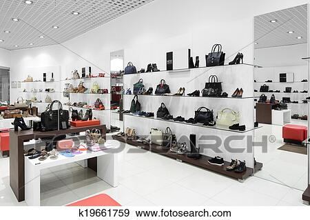 Stock photograph of interior of shoe store in modern european mall