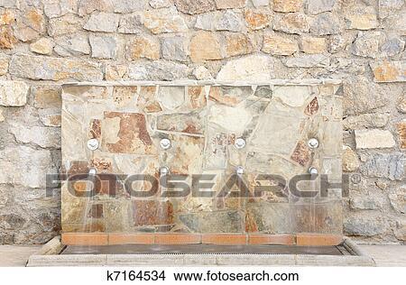 Coleccion De Foto Riegue Fuente En Pared De Piedra K7164534 - Fuentes-de-piedra-de-pared