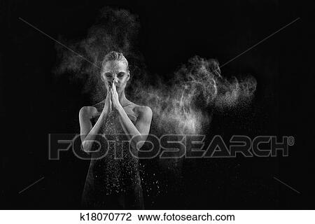 Beautiful Woman With Stop Motion Of Explosive Powder Captured By Flash