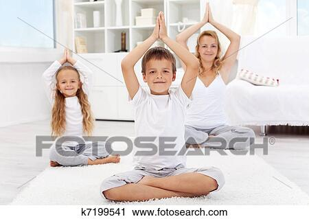 Happy balanced life - people doing yoga exercise Stock Image
