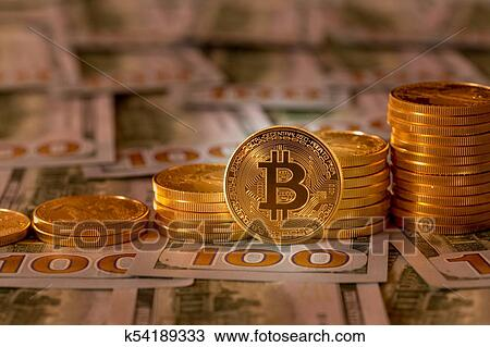 Stock Photo Bitcoins Stacked On New Design 100 Dollar Bills Fotosearch Search