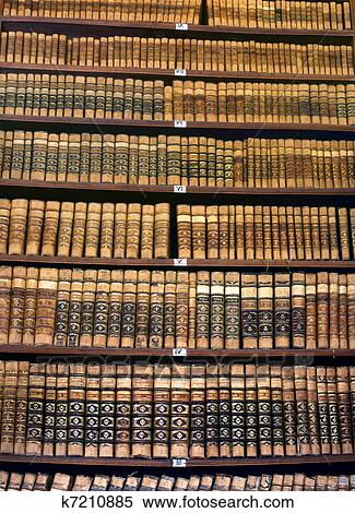 Stock Image Of Old Books At A Library Bookshelf K7210885