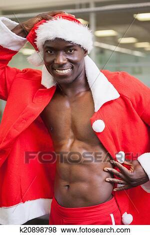 2774dbe9fc487 Macho man in santa costume at the gym Stock Photo