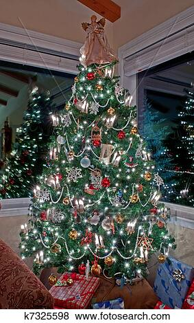 Christmas Decoration Indoors.Vertical Tall Decorated Christmas Tree Indoors Stock Photo