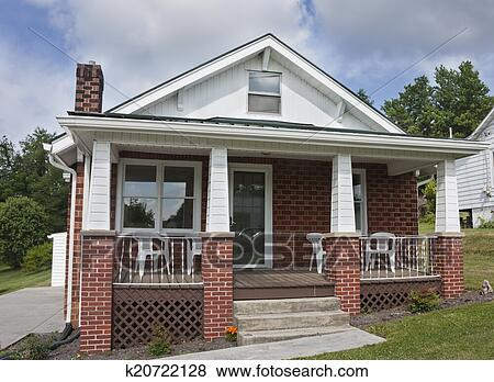 Brick House With Porch Stock Photo