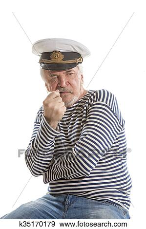 Portrait of old sailor man in striped shirt and hat smokes smoking pipe  isolated on white background 92e913038de