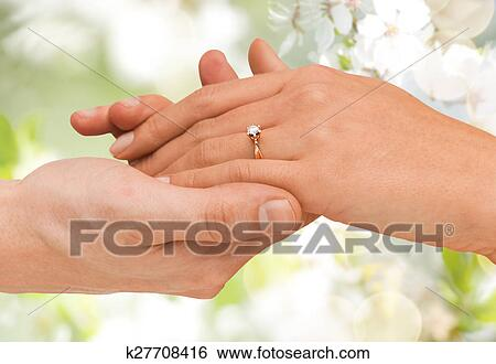 Stock Image Close Up Of Man And Woman Hands With Wedding Ring Fotosearch