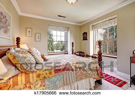 Stock afbeeldingen warme kleuren slaapkamer met een