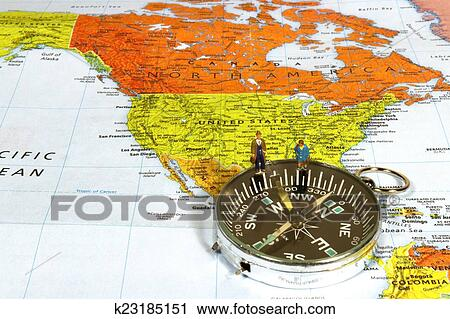 Stock Photography of Business man and woman on map showing the ...
