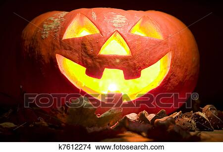 Stock Photo Of Creepy Pumpkin With Candle In Mouth Halloween